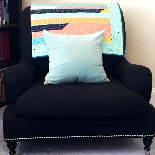 jelly-roll-race-quilt-on-a-chair